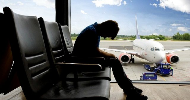 Man in airport who needs tips to avoid jet lag
