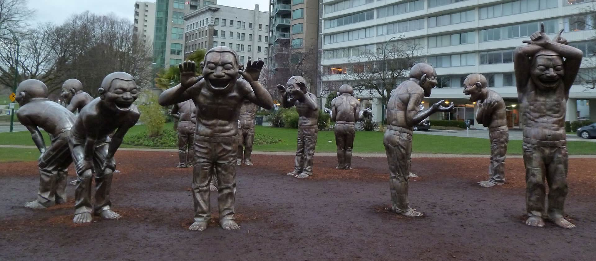 Vancouver Public art in Coal Harbour - A-maze-ing Laughter, a sculpture by Yue Minjun