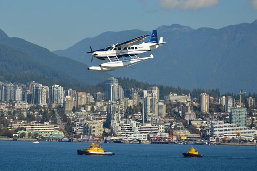 A seaplane flying into Coal Harbour, a great place to stay in Vancouver
