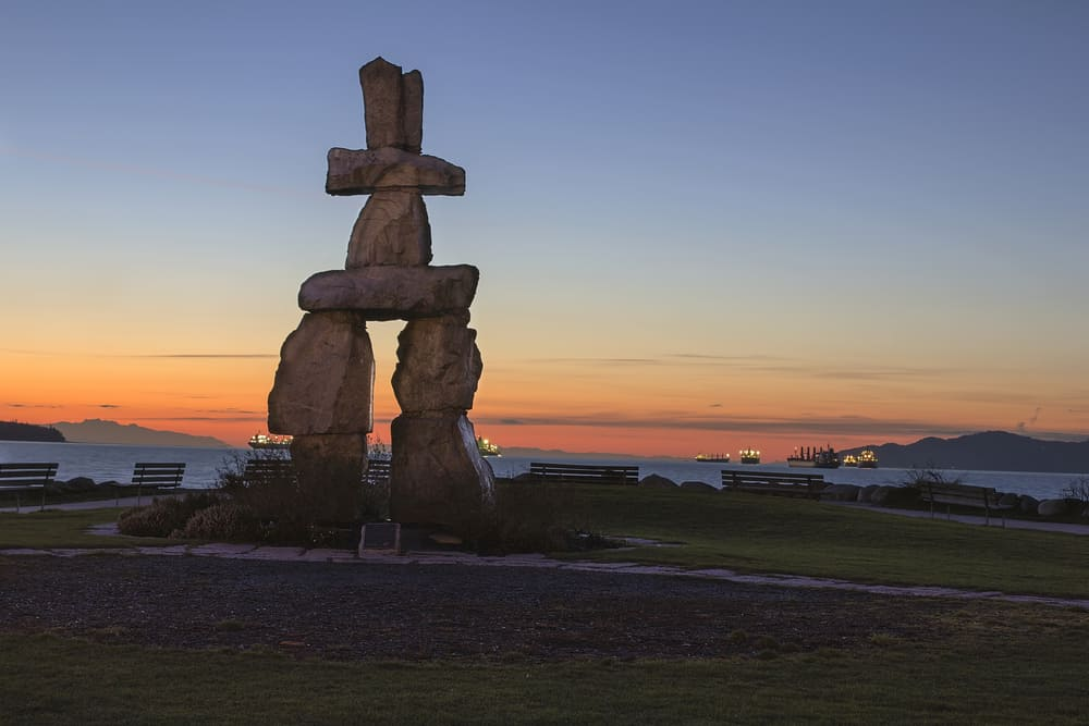 Inukshuk figure at English Bay, Vancouver - products unique to canada