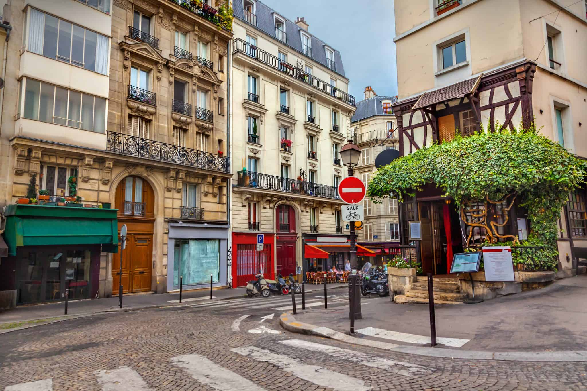 A beautiful street to walk on in Montmartre, Paris - something every first time visitor to Paris must experience