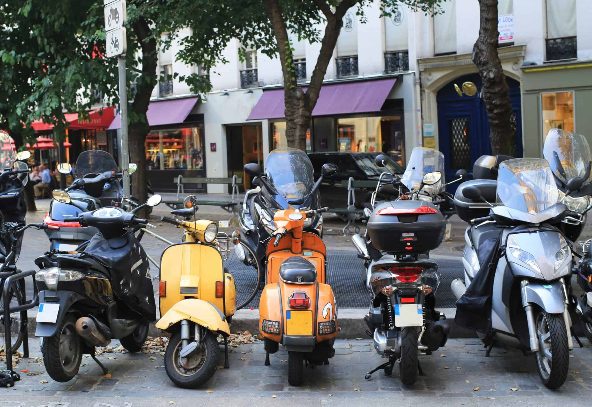 A crowd of scooters in Paris - a unique sight for first time visitors to Paris